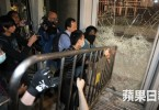 Protesters using barriers to smash the LegCo glass door. Photo: Apple Daily.