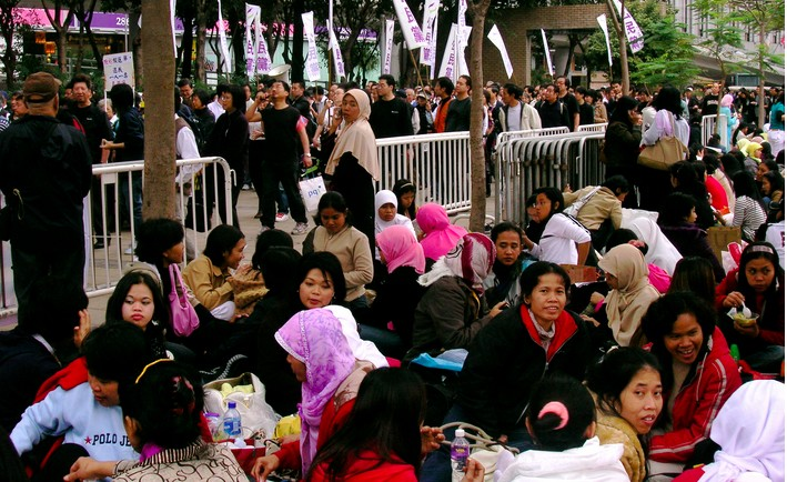 Foreign domestic workers gathering outside Victoria Park. Photo: Wikimedia Commons.