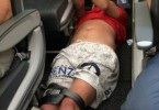man restrained on flight