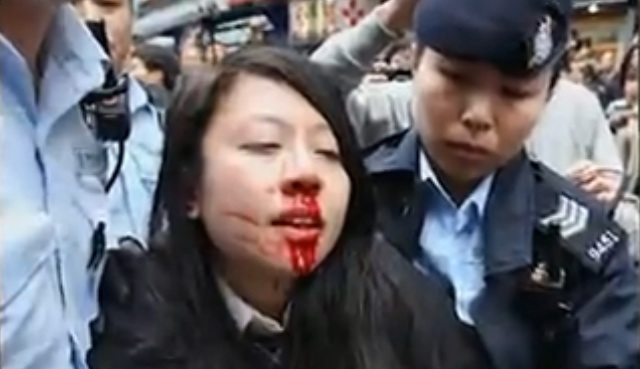 Ng Lai-ying was arrested during an anti-parallel trading protest in Yuen long. Photo: Apple Daily.