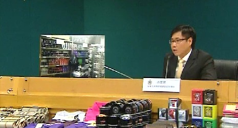 Customs spokesman with the seized counterfeit goods.