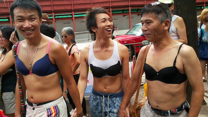 male protesters wearing bras in support
