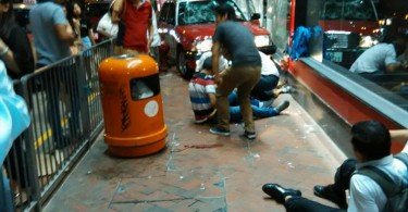 A taxi crashed onto Wan Chai pavement on Wednesday night.