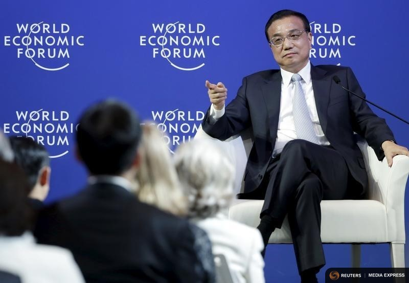 China's Premier Li Keqiang answers a question during a meeting with foreign company executives at the WEF in Dalian