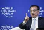 China's Premier Li Keqiang answers a question during a meeting with executives from foreign companies at the World Economic Forum (WEF) in China's port city Dalian