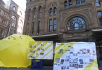 Two display boards and giant yellow umbrella in Sydney to commemorate the anniversary of the protest.