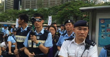 Police taking videos at a protest.