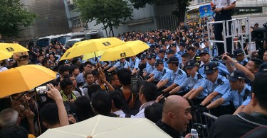 Police stand off with protesters at the Occupy anniversary commemoration.