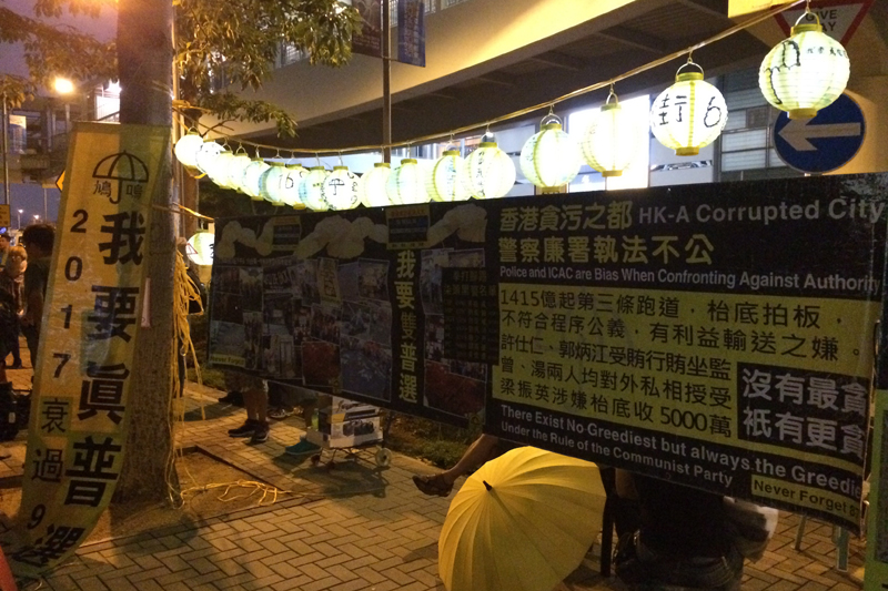 booth near Civic Square demanding genuine universal suffrage for Chief Executive and the LegCo