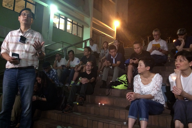 Ip Kin-yuen speaking at the vigil.