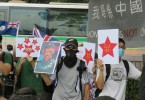 Protesters raised anti-Communist Party banners