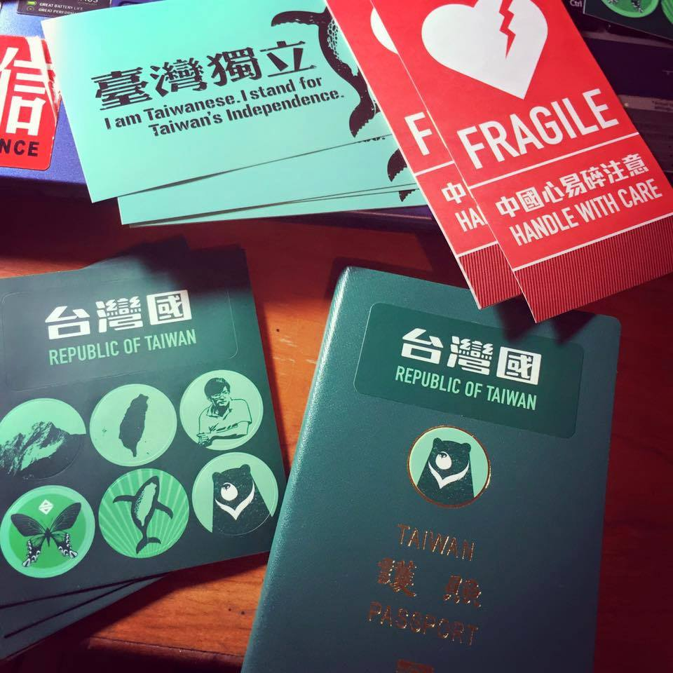 Taiwanese passport with stickers. Photo: Denis Chen via Facebook.