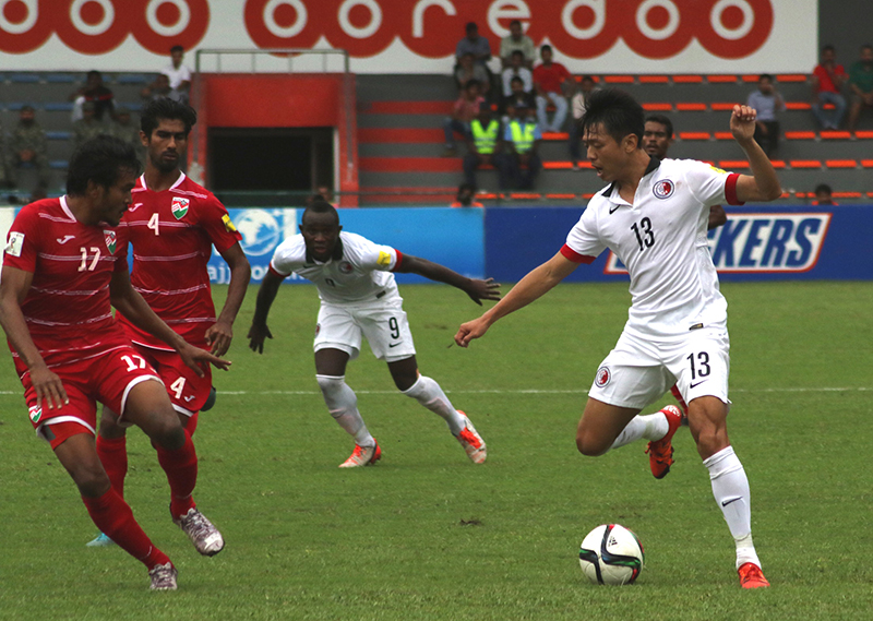Hong Kong's Cheung Kin-fung against Maldives players.