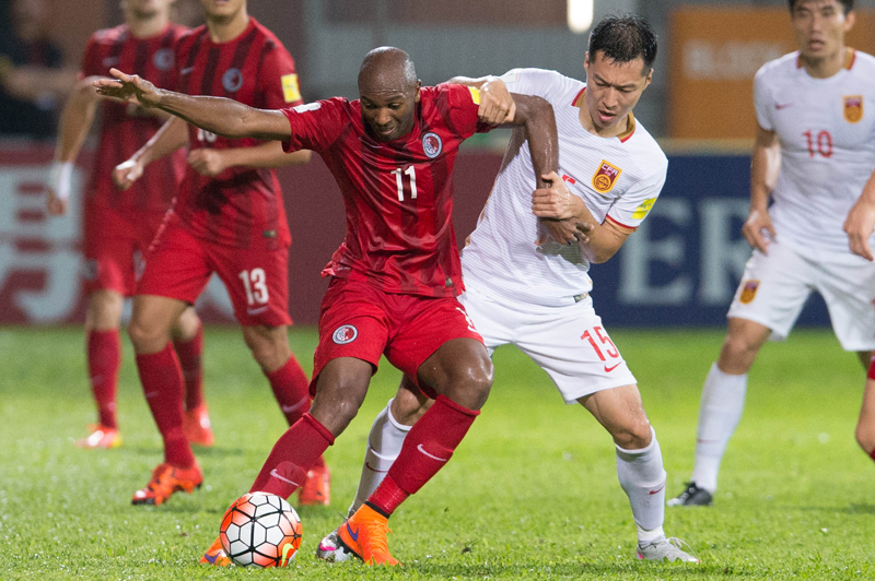Hong Kong player Sandro against Chinese player Wu Xi. Photo: Hong Kong Football Association.