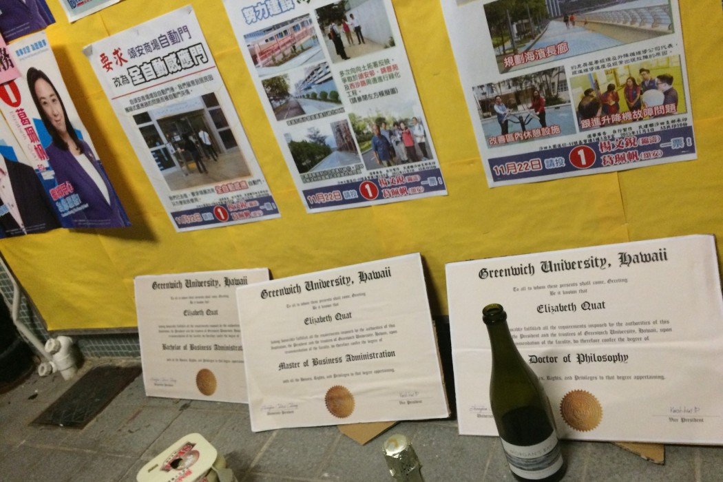 "Organisers printed out several ""fake"" university graduation certificates for Elizabeth Quat."