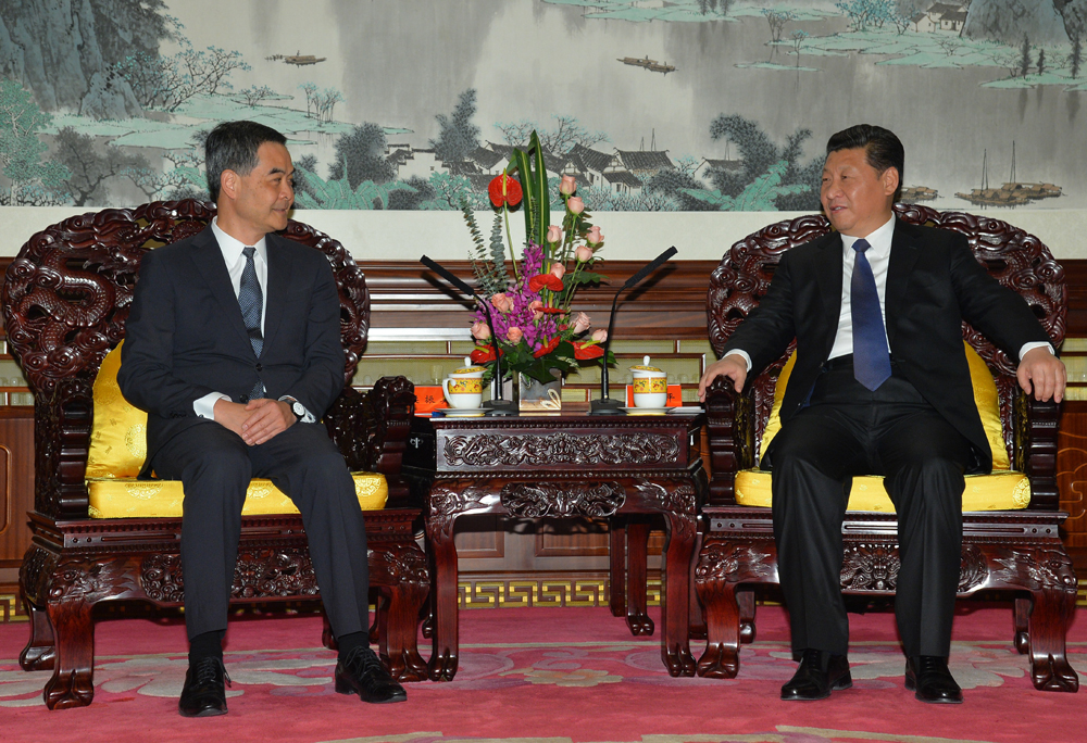 Leung meeting Xi in 2014 on the same kind of seats.