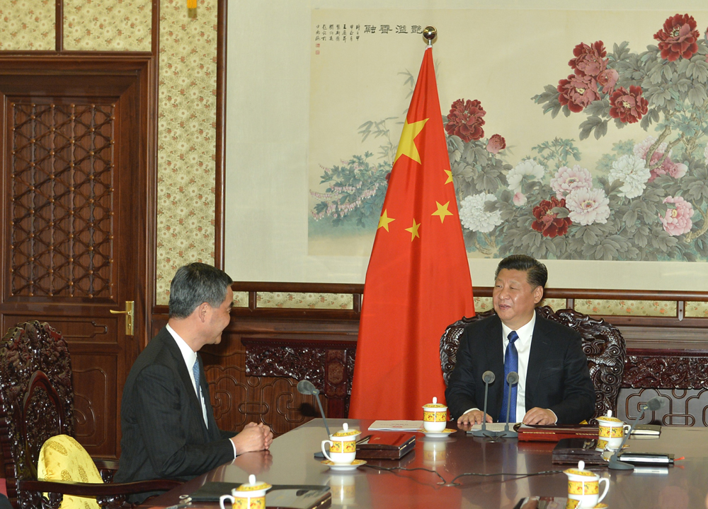 Leung meeting Xi this year at a side seat.