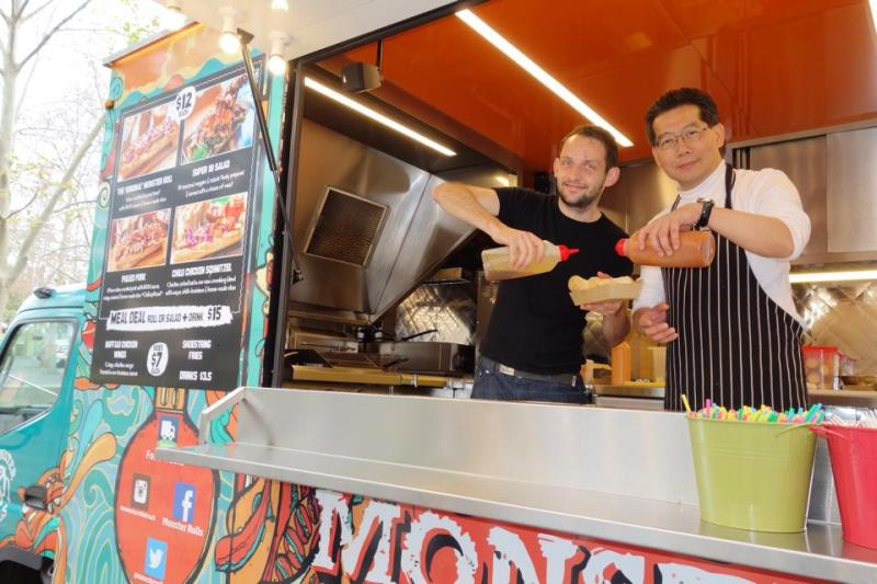 Gregory So (right) visiting a food truck in Australia in August.