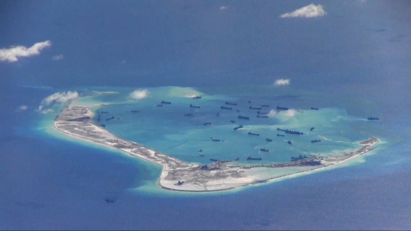 Chinese dredging vessels are purportedly seen in the waters around Mischief Reef in the disputed Spratly Islands in the South China Sea in this still image from video taken by a P-8A Poseidon surveillance aircraft provided by the United States Navy May 21, 2015. Photo: Reuters.