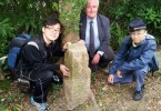 (From left) HKU tutor Mr Chan Yiu-hung, lecturer Dr Stephen N.G. Davies, and tutor Mr Choi Cho-hong with the B.O. No4. boundary stone.