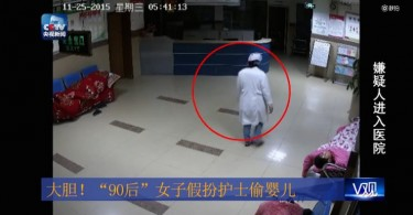Screenshot of CCTV video on woman stealing baby