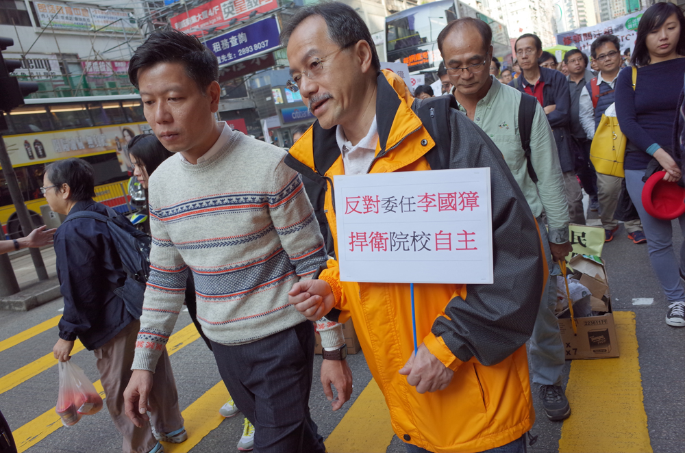 Lawmaker Fernando Cheung with a banner opposing the appointment of Arthur Li.