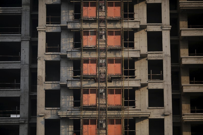Unfinished apartments are seen at the construction site of Zixia Garden development complex in Qianan, Tangshan City, Hebei province. Photo: Damir Sagolj, Reuters.