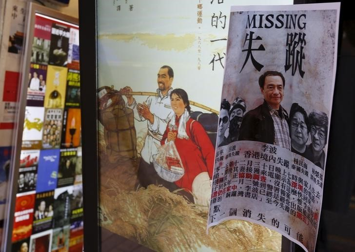 A printout showing Lee Bo, specializing in publications critical of China, and four other colleagues who went missing, is displayed outside a bookstore at Causeway Bay shopping district in Hong Kong, China January 6, 2016.   Photo: Reuters/Bobby Yip.
