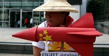 A protestor from League of Filipino Students and Kabataan (Youth) Party list group holds an effigy symbolising a missile and placards during a rally by more than a dozen students outside the Chinese Consulate in Manila