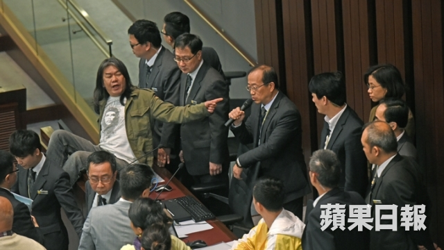 Lawmakers have attempted to occupy the chairman's table at the conference room 1 during a Finance Committee meeting on February 27.