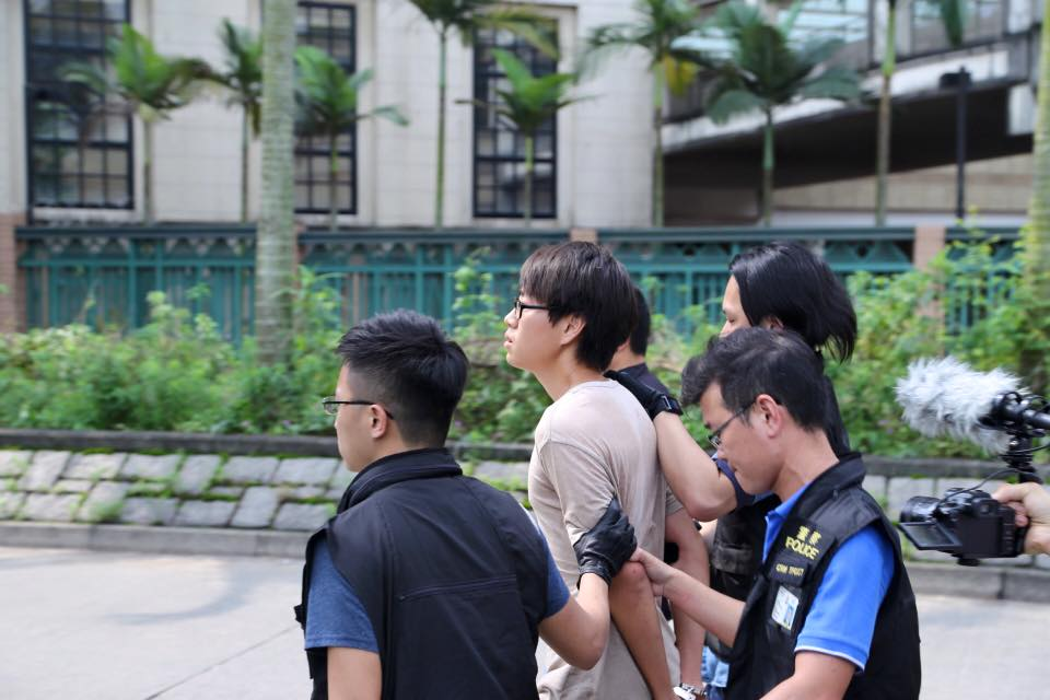One activist being arrested by police.