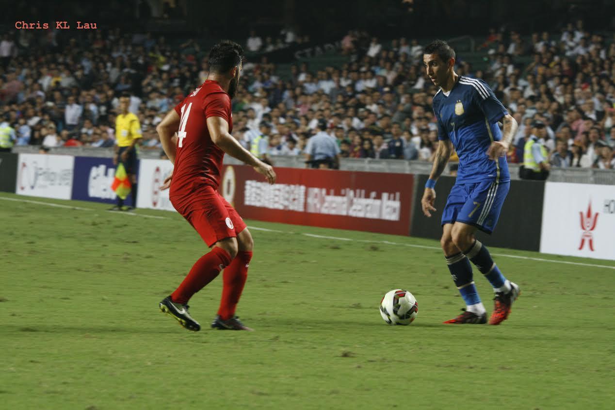 Jack Sealy defending against Argentinian international Angel Di Maria.