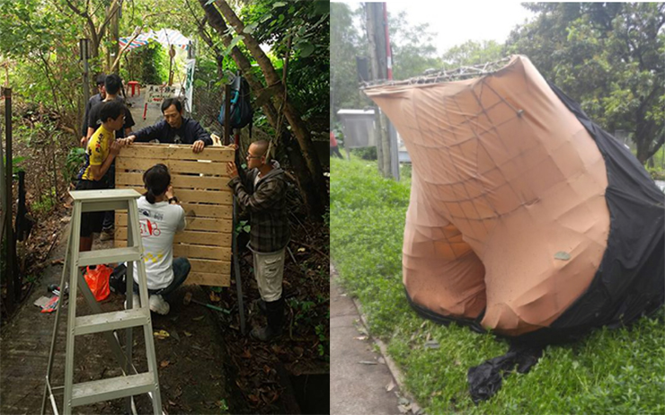 "Activists building building wooden barricades; an ""ass"" structure built by activists claiming to be for Henderson's Lee Shau-kee."
