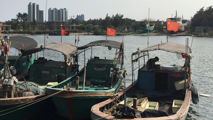 Fishing boats are seen at a harbour in Baimajing, Hainan province