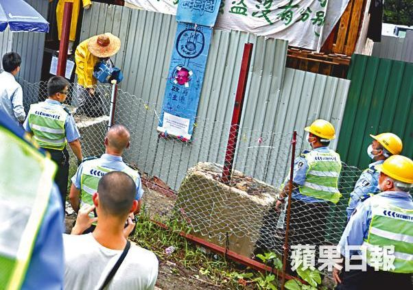 protester climbs out of premises ma shi po