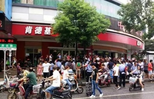 Protesting outside a KFC branch