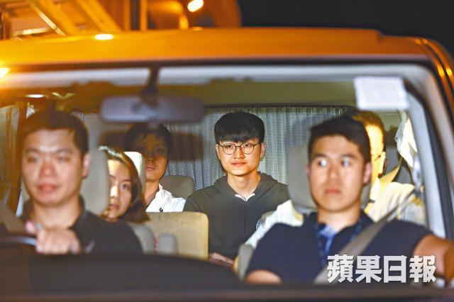 Billy Fung Jing-en in police car
