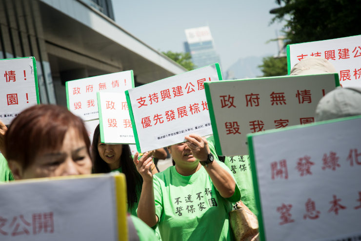 Villagers marching with placards