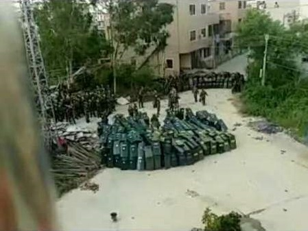 Violent standoff, raids and tear gas as police arrest 13 in Wukan democracy village