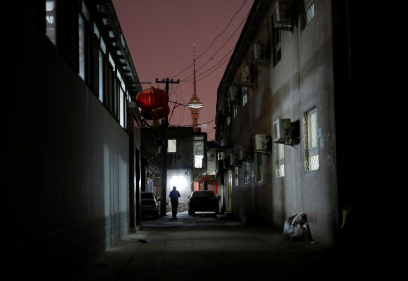 A man walks past the accommodation where some patients and their family members stay while seeking medical treatment in Beijing, China, April 21, 2016. Photo: Reuters/Kim Kyung-Hoon.