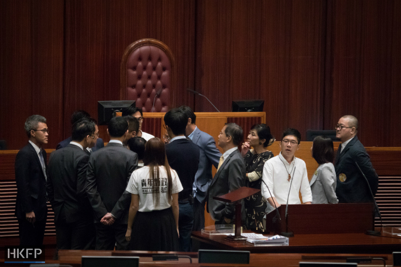 lawmakers-surround-legco-secretary-general