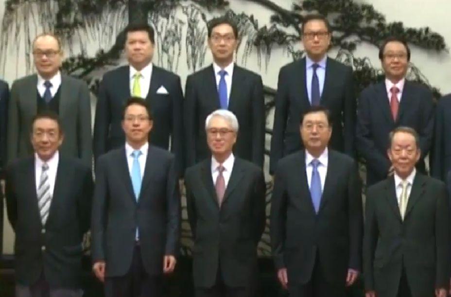 Robert Chow (centre front) standing between Zhang Xiaoming and Zhang Dejiang. Photo: TVB screenshot.