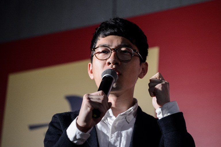 Pro-democracy lawmaker Nathan Law speaks during a rally in Hong Kong on December 11, 2016, against a crackdown on pro-democracy lawmakers and an electoral system skewed towards Beijing ahead of elections for a new city leader. Photo: AFP/Anthony Wallace.