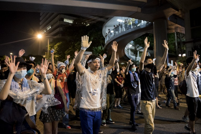 hands up democracy occupy hong kong protest umbrella