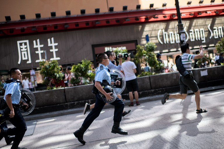 police chase democracy occupy hong kong protest