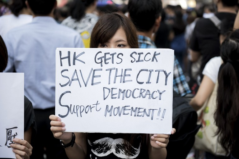 save democracy occupy hong kong protest umbrella