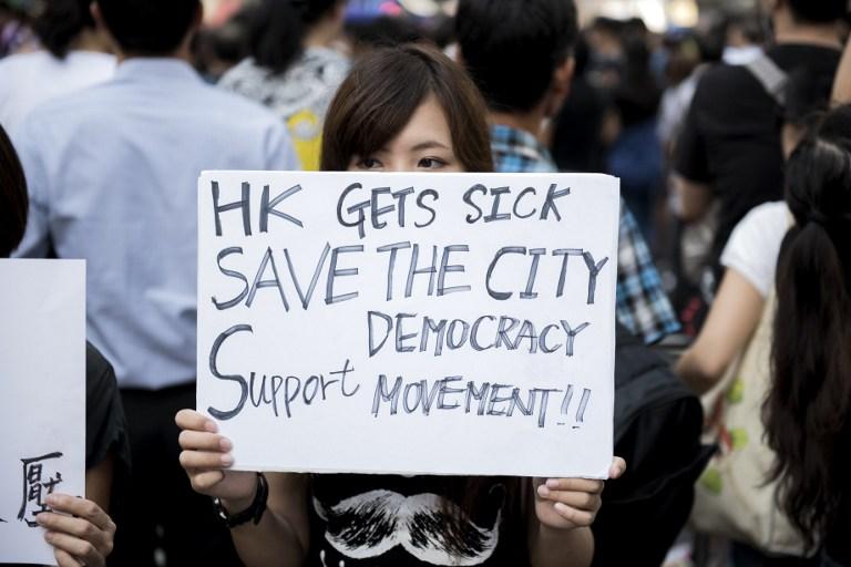 save democracy occupy hong kong protest umbrella