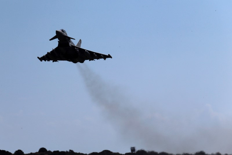 A Royal Air Force Typhoon aircraft takes off from RAF Akrotiri in Cyprus for a mission in Iraq