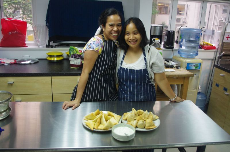 """Domestic helpers Elaine (Left) and """"Melissa"""" have learned to make an Indian dish"""