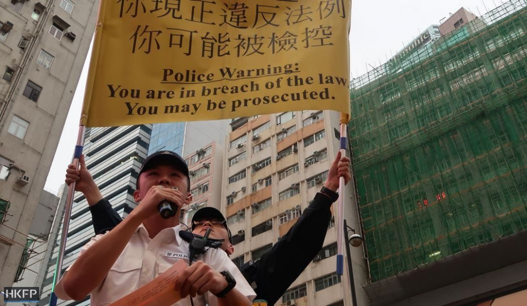 police warning yellow flag protest